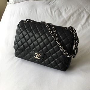 CHANEL black quilted caviar bag